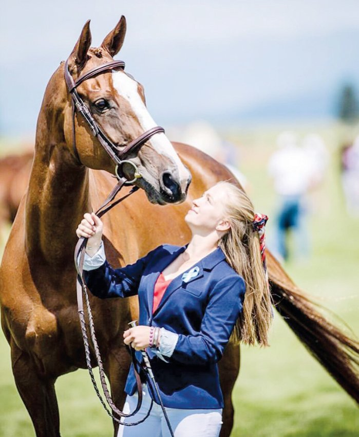 Pittsboro's Dylan Phillips walks her horse Fernhill Fierce (Rizzo) before competiting in the 2019 Adequan/FEI North American Youth Championships Junior Olympics in Kalispell, Montana. Phillips has been riding her Irish Sport Horse Rizzo for two years.