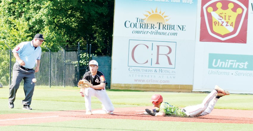 American Legion Post 45's Harris Jackson waits for the toss from home plate as Post 180's Ryan Dooley slides safely into third in recent American League action.