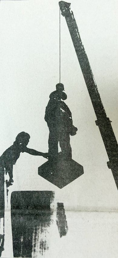 """The soldier atop the """"Our Confederate Heroes"""" monument is removed from its pedestal in this photo from the August 4, 1988, edition of The Chatham Record."""