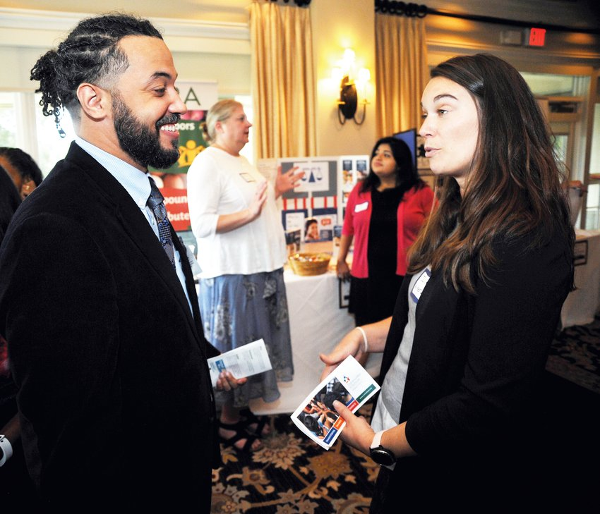 Travis Patterson hears more about health care in Chatham County from Julie Wilkerson, coordinator of the Chatham County Health Alliance. Wilkerson said that she was 'excited about seeing the friendly faces I'll work with at the United Way and NC Care 360.'
