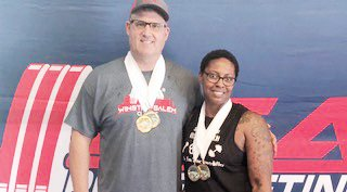 Eric Andrews (left) and Michelle Jordan show off their medals after a successful competition at the USAPL Winston-Salem Classic in Saturday, Aug. 31. Jordan captured two Golds while Andrews added a Gold and two Silvers at the event.
