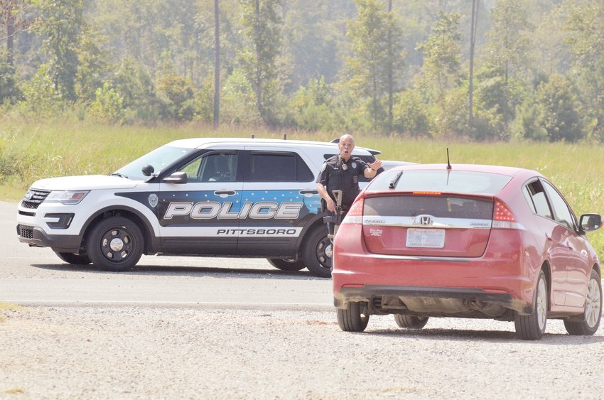 Pittsboro Police personnel guarded the safety of residents, guiding them away from the potential danger of the Credit Union last Thursday.