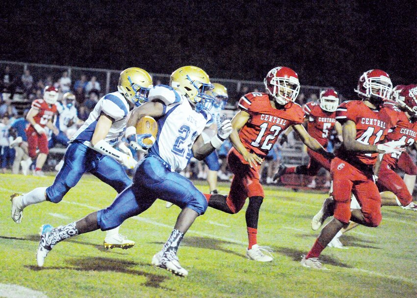 Jordan-Matthews' Jacquez Thompson flows through and around the Chatham Central defensive secondary in the first half of their game last Friday night in Bear Creek. The first inter-county rivalry game of the season ended with Jordan-Matthews first victory of the season, 56-30.