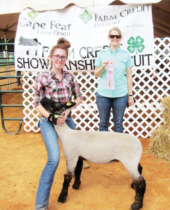 As Judge Callie Birdsell Carson looks on, McKenzie Beason wins Reserve Grand Champion Lamb.