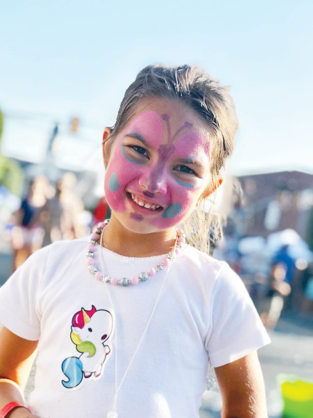 Painted face..Birdie Pedraza, the 5-year-old daughter of Elizabeth and Juan Pedraza of Briar Chapel, shows off her painted face at Saturday's PepperFest in downtown Pittsboro. Mom Elizabeth says she's attended all 12 PepperFest events, and was enjoying the event's attractions with Birdie.
