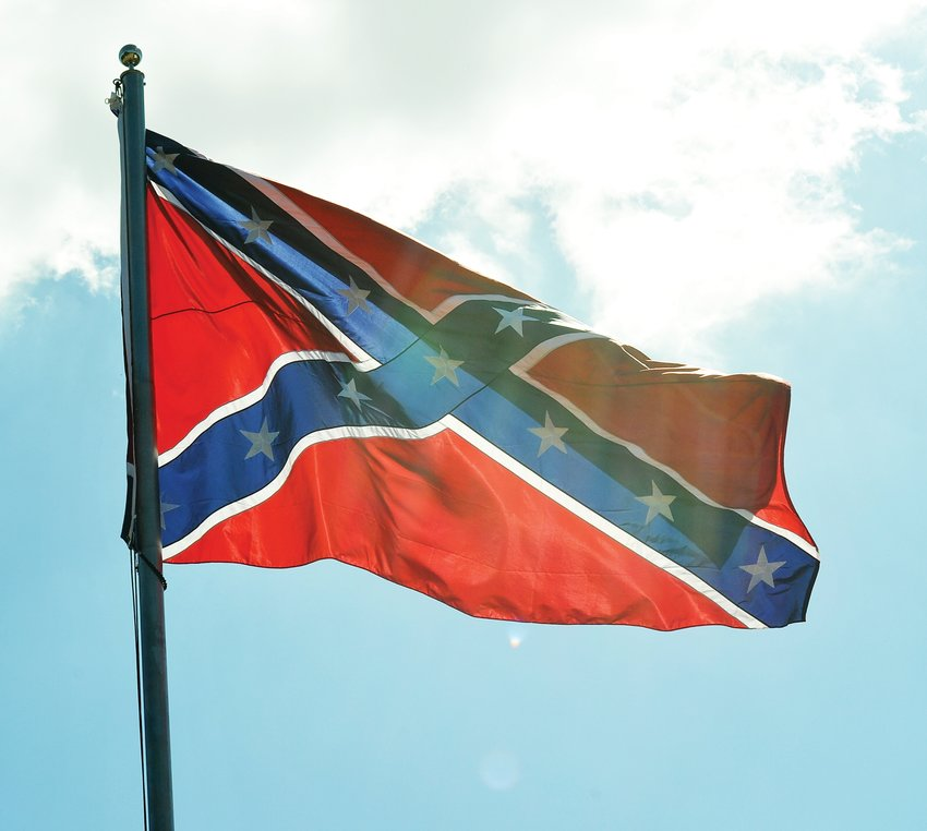 The Confederate Battle Flag flies over the Highway 64 area in Pittsboro. The flag was placed in the area recently.