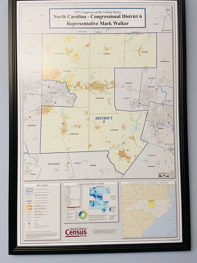 A map of Walker's 6th Congressional District hangs in his office. Chatham County was added to the district in time for the 2016 election. It previously was split between the 2nd and 4th Districts.