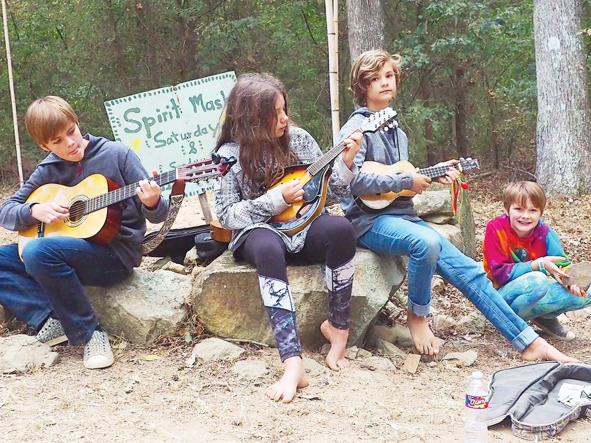 Odin, Georgia, Eden and Beau of Pittsboro played some classic Appalachian style music for those who passed by.