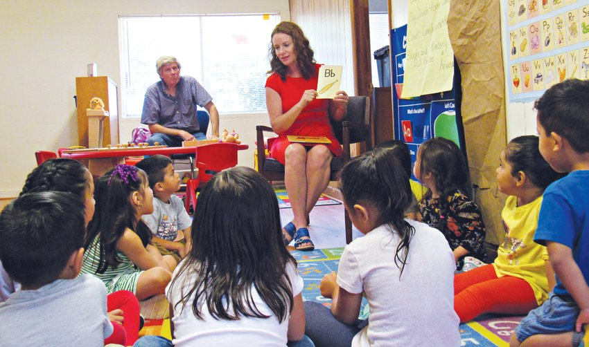 Meghan Friday, preschool director at The Learning Trail, helps her preschool students pronounce the word 'cat' during a recent class session.