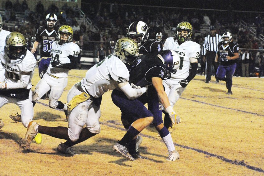 Eastern Randolph's  Kaemen Marley comes in for the tackle on West Stoke's Cortlen Dutton last Friday night in King. The two teams, in combat to advance to the third round of the 2A playoffs, fought hard until the last play, with West Stokes winning 26-21.