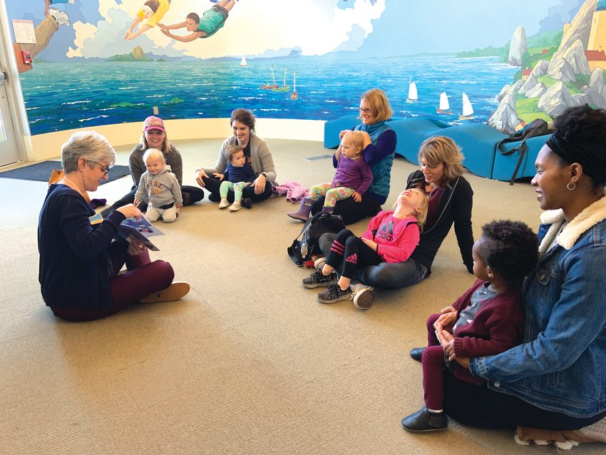 Toddler Time presenter Michelle Morehouse reads 'Black Dog Gets Dressed' to a group of toddlers and parents last week at the Chatham Community Library.
