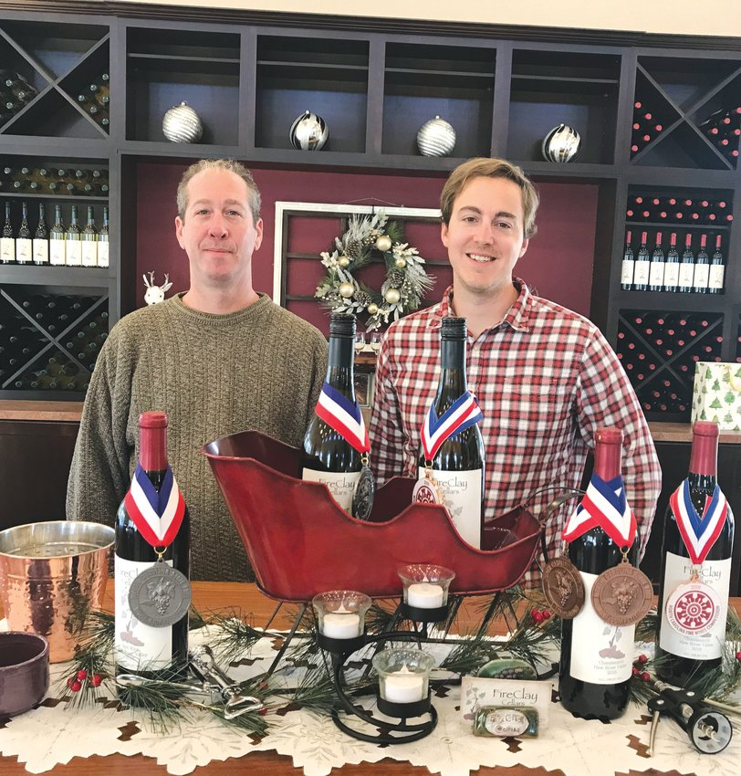 Beau Hall (left) and Erik Mitran pose inside the tasting room at FireClay Cellars. The winery's creations have won numerous awards in wine competition across the region. Mitran, a co-owner of the winery, says 1,200 new vines will be planted in the vineyard this spring.