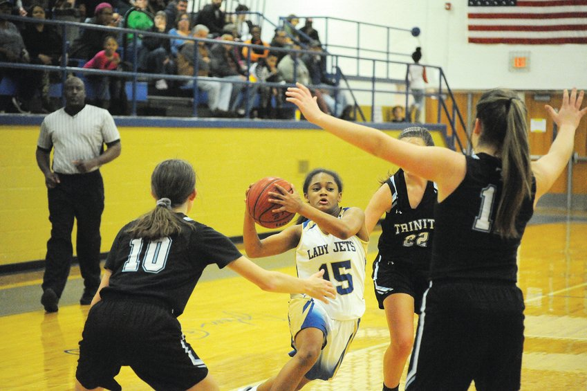 Trinity's Graci Gibbs (10), Autumn Gentry and Hannah Lewis triangulate on Jordan-Matthews' Ellia Wright late in a game Jan. 7. The Lady Jets' offense flew high and scored big with a 57-34 drubbing of the Bulldogs.