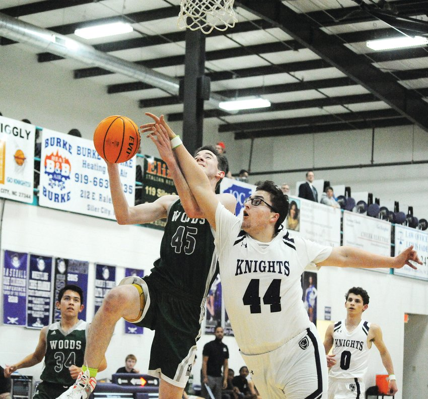Woods Charters' Patrick Deegan goes up for a layup and gets blocked by Chatham Charter's Trevor Golden in the first half of their matchup last Friday in Siler City. Chatham Charter added another win to their winning season, 85-47, adding another win to their impressive season record, 21-1.