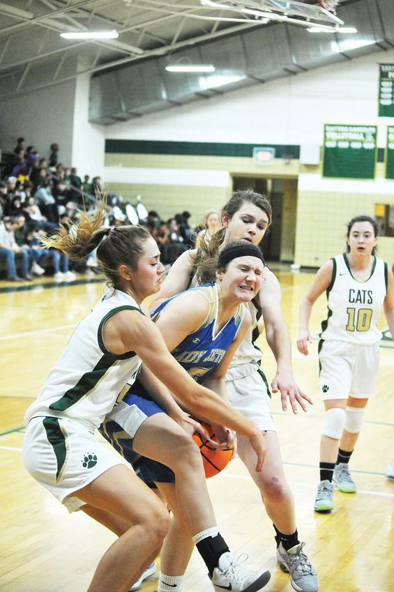 Eastern Randolph's Savannah Beaver, front, and her teammate Fallon Cain cage Jordan-Matthews' Ashlyn Ray as Wildcat team Captain Lilly Whitaker watches in a bruising rout in Ramseur Jan. 28. The Wildcats were victorius in the home game, 63-34, and brought their season record to 9-10.
