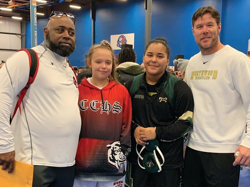 The 2nd annual NCHCAA Women's Wrestling State Championships took place last Saturday in Concord and two Chatham County wrestlers competed. Pictured (from left) are Chatham Central coach Sherman Howze, Chatham Central's Hailey White, Northwood's Dream Walker and Northwood coach Jason Amy.