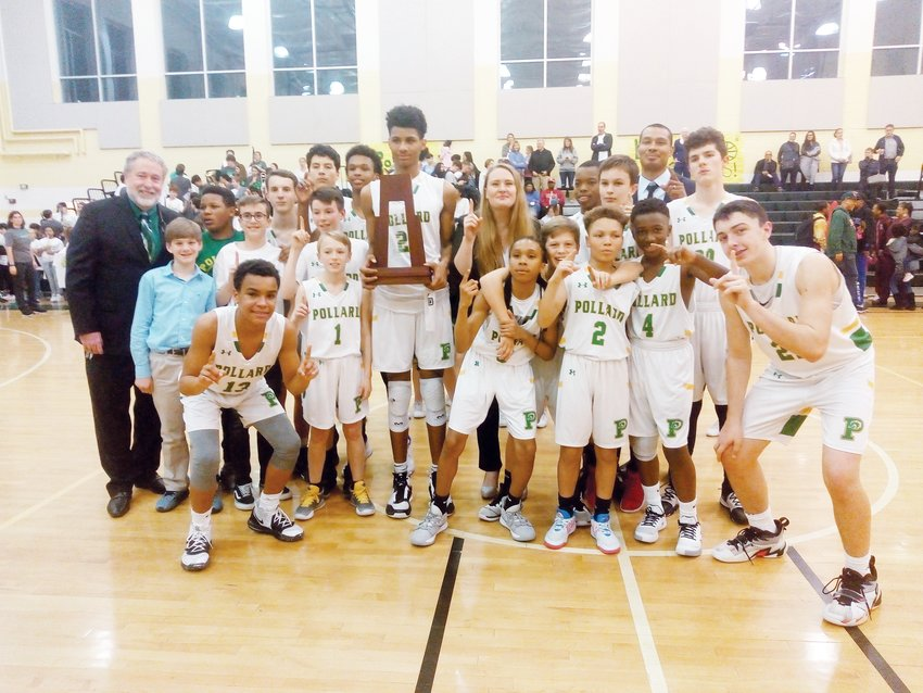 The 2020 Boys Middle School Tournament Champions, the Margaret Pollard Mustangs, pose after their victory over Bennett Middle School. The two teams were tied at 30-all near the end of the third quarter before the Mustangs broke free to a 59-48 victory.