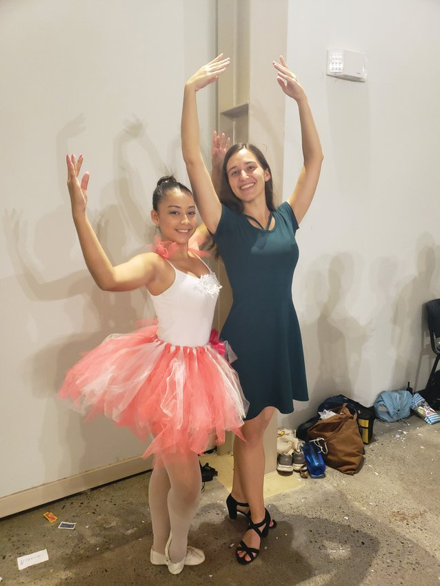 Shannon Grand (right) is spending two years teaching English in Costa Rica with the Peace Corps. While there, she is teaching ballet classes to 60 students, culminating in a performance of the Nutcracker.