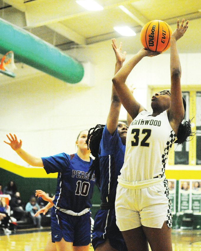 Northwood's Te'keyah Bland goes for a lay-up against Person High in their state playoff championship game Feb. 27 in Pittsboro.