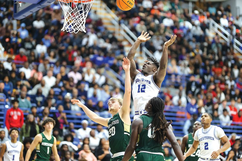 Westover's Keyshawn Lindsey goes up for a basket over Northwood defenders Jack Thompson (20) and Aaron Ross (0) during the NCHSAA Regional Championship game on Saturday at Fayetteville State University.