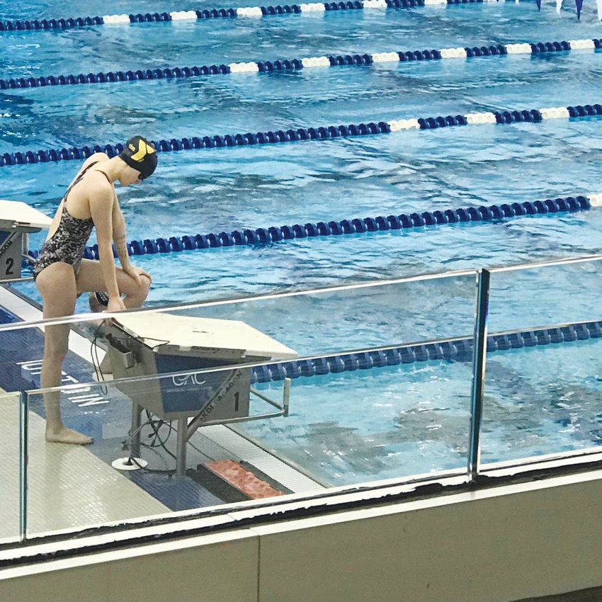 Jenna Fadely of Siler City prepares to take the starting platform in meet action earlier this season. Fadely is up for consideration for All-American honors nationally.