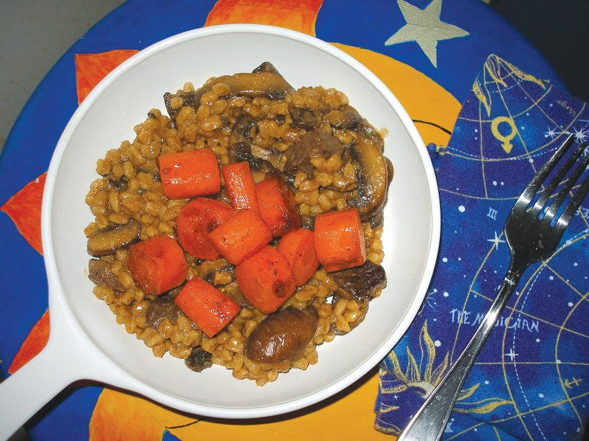 Beefy farro pilaf topped with glazed carrots, as prepared by Debbie Matthews.