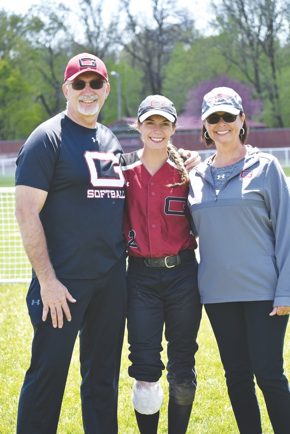 Kayli Blakenship (center) enjoys a photo opportunity with her father Gary(left), and mother Etta (right) at a game earlier this season. Like most, the Blankenship family has logged a lot of miles through the years traveling around the country playing softball.