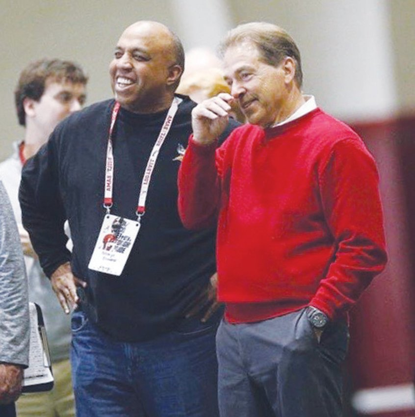 Siler City's George Edwards (left) shares a laugh with Alabama head coach Nick Saban at a Crimson Tide Pro Day in 2018. Edwards and the Dallas Cowboys are gearing up for the 2020 NFL Draft which will be conducted virtually beginning on Thursday, April 23.