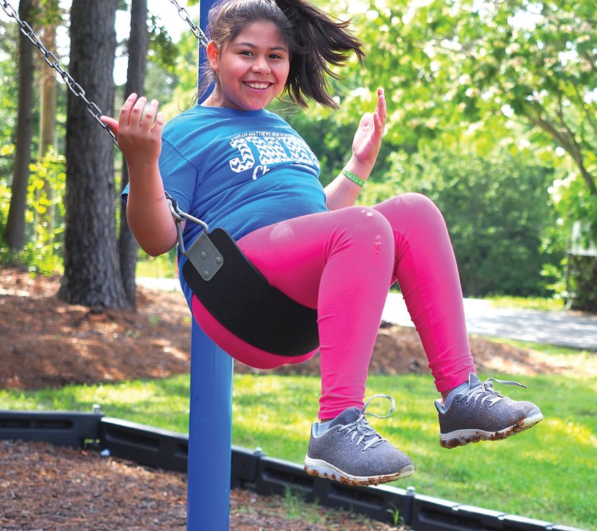 Boys & Girls Clubs member Brianna Balderas loves to swing at the Wren Family Center in Siler City.