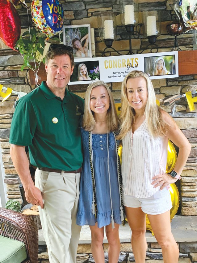 Parents Jason, left, and Heather Amy flank their daughter Kayla, a recent Northwood High School graduate who is heading to St. Andrews University in Laurinburg on an equestrian scholarship. Jason serves as Northwood's co-athletic director.