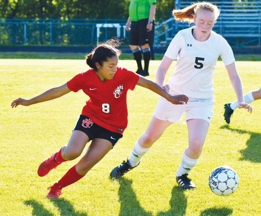Woods Charter's Anna Mitchell (5) and Chatham Central's Brenda Soriano (8) chase a loose ball in a girls soccer game on May 2, 2019.