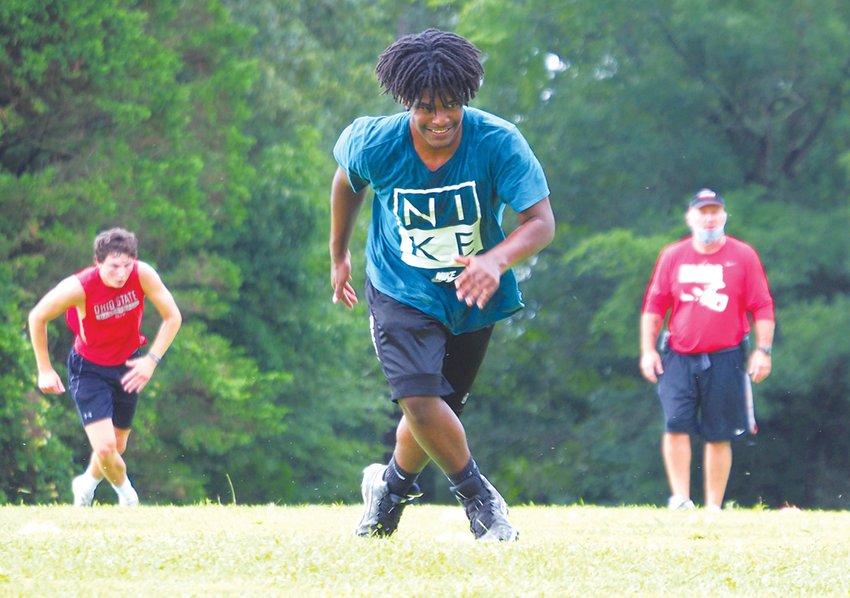 Devin Cheek, a junior linebacker, runs during a conditioning drill on July 8.