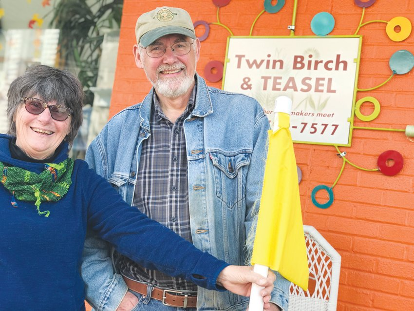 Twin Birch owners Sue and Rich Szary stand outside their downtown Siler City store, which also houses studios for customers.