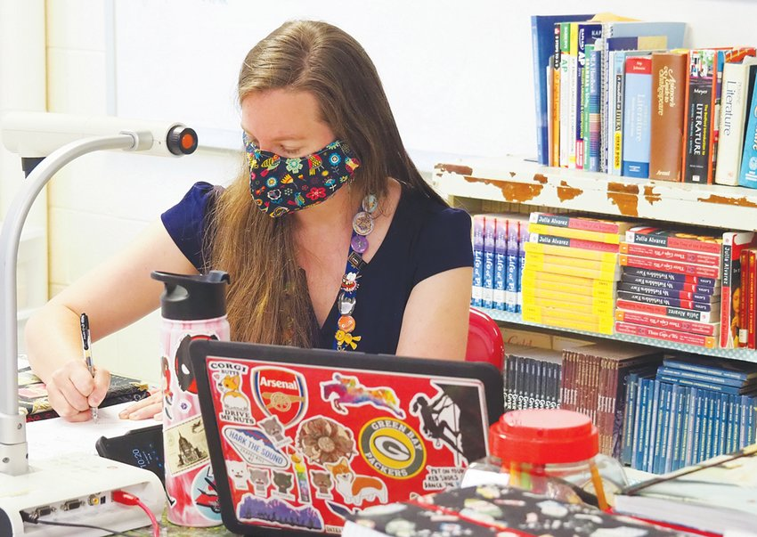 Like lots of other teachers, Sarah Harris has been logging extra hours to prepare for remote lessons. 'It's probably easily double the work in remote,' she said.