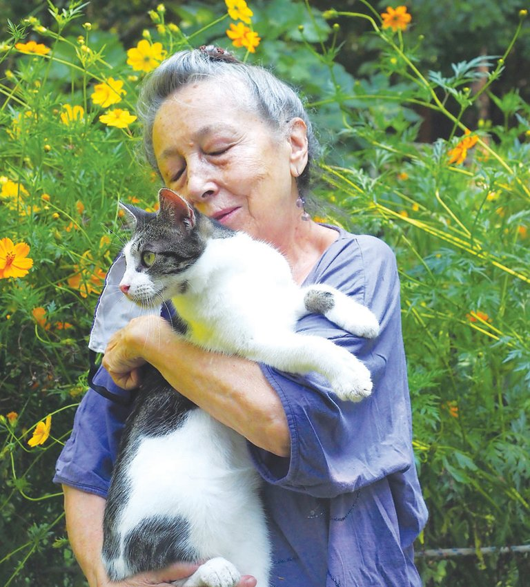 Siglinda Scarpa, founder of the Goathouse Refuge in Chatham County, has spent a lifetime creating art and sharing love with any animal she meets. Story, photos on page B4.