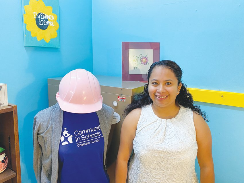 Jazmin Mendoza Sosa's office at Communities In Schools includes this pink hard hat — given to her by the CIS staff, she says, 'because I wear so many hats.'