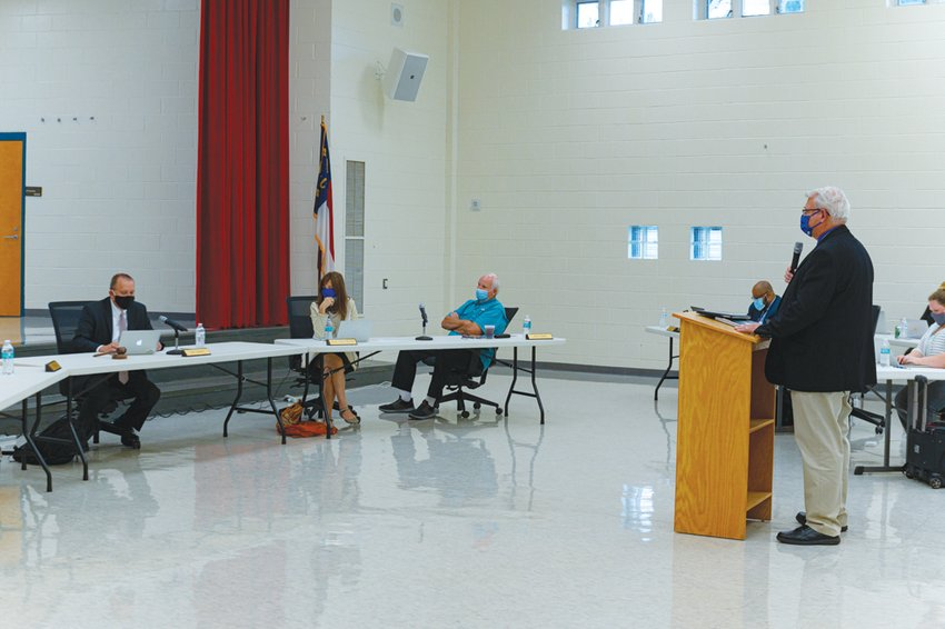 District athletic director Chris Blice (right) presented an updated workouts plan to the Board of Education on Sept. 29.