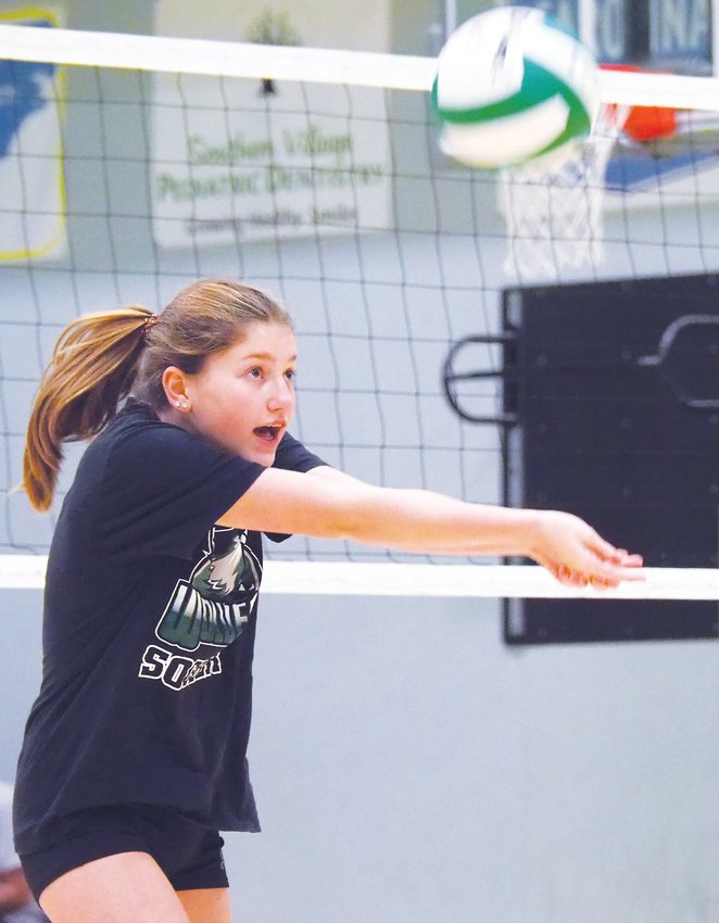 Woods Charter's Megan Nowak follows through after passing a ball during a volleyball drill on campus in October.