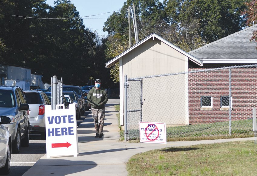 A man walks to cast a vote at the Bonlee School Gym on Election Day Tuesday.