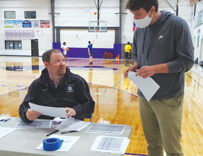 Chatham News + Record sports editor Chapel Fowler speaks with Chatham Charter athletic director Clint Fields at an offseason skill session in June.