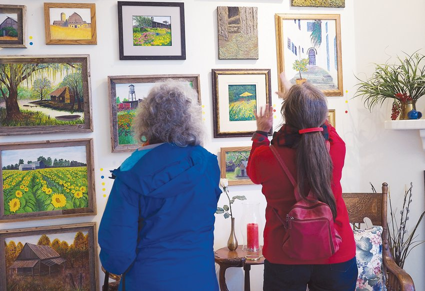 Shoppers in the 2019 Studio Tour perused these Forrest Greenslade paintings.