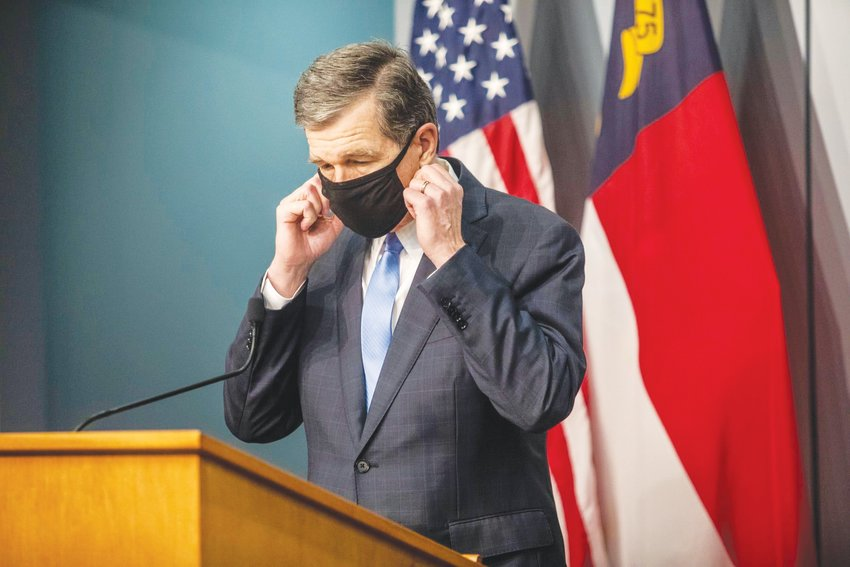 'Easing these restrictions will only work if we keep protecting ourselves and others from this deadly virus,' Gov. Roy Cooper said Wednesday.
