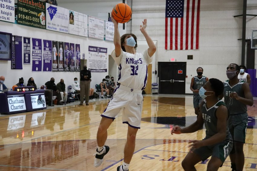 Chatham Charter sophomore forward Adam Harvey (32) had 11 points in Tuesday's win over Research Triangle.