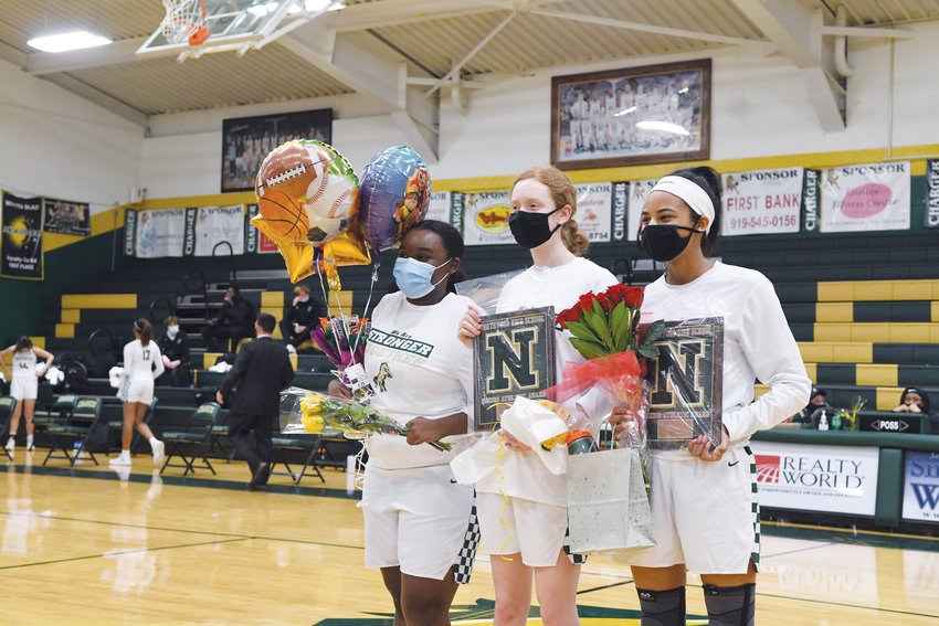 From left, Northwood women's basketball seniors Jamaria Faucette, Jillian McNaught and Rae McClarty were honored ahead of a Jan. 15 home game against Orange.