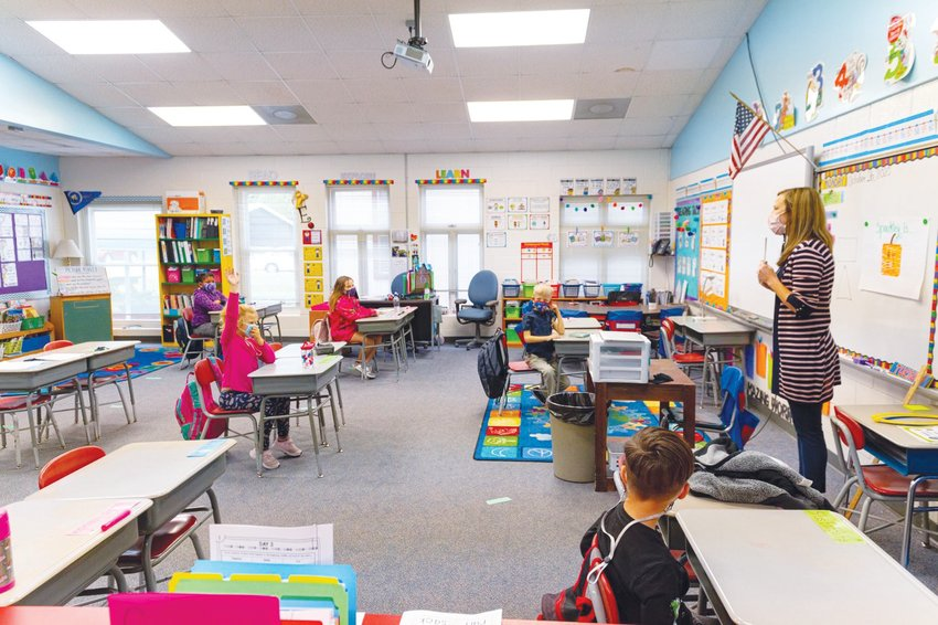 Students in a 1st and 2nd grade classroom at Bonlee School, pictured here during the second week of hybrid learning at the end of October. Last Tuesday, the CDC urged schools to reopen and said it was safe to do so with proper protocol.