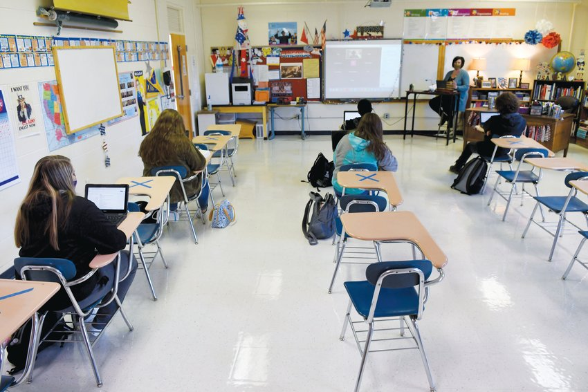 Under the current hybrid schedule, one group of students attends in-person classes Monday and Tuesday, while another group attends virtually. The two groups switch on Thursday and Friday, with Wednesday a fully remote day to allow for through cleaning.