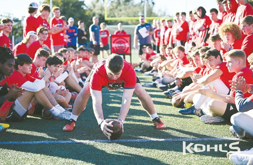 Northwood's Jake Mann prepares to snap a football at a Kohl's camp.