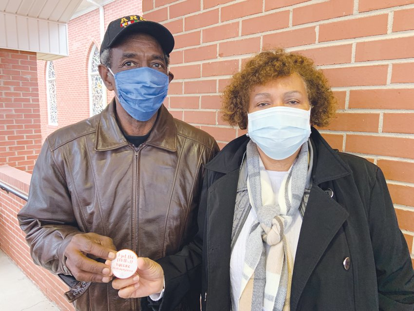 James, left, and Delphine Womack, members of Roberts Chapel Missionary Baptist Church in Goldston, hold up an 'I got the COVID-19 vaccine!' button during Friday's COVID-19 vaccination event on the church's campus. The Womacks were instrumental in organizing Friday's event.