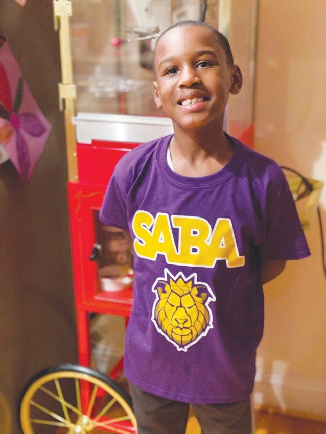 School of the Arts for Boys Academy founder Valencia Toomer's son, Tyson Toomer, rocking one of the school's new shirts. The school is set to open in fall 2021.