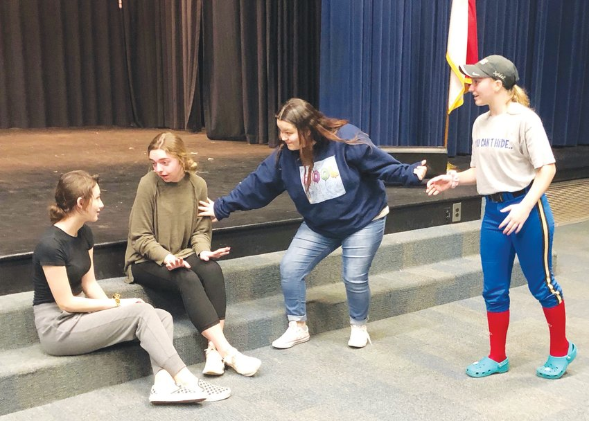 Jordan-Matthews actors — Rilee Rains, from left, Lindley Andrew, Laci Burt and Hannah Redding — rehearse 'The Lottery' one year ago, just before the pandemic took hold. Burt and Redding will be on stage this year when the play finally returns.